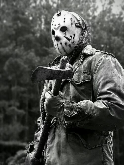 jason voorhees with a white mask and axe